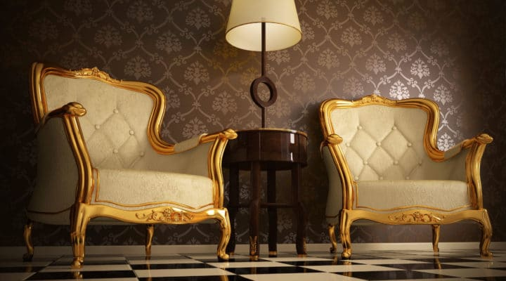 Armchairs gilded with golden leaf