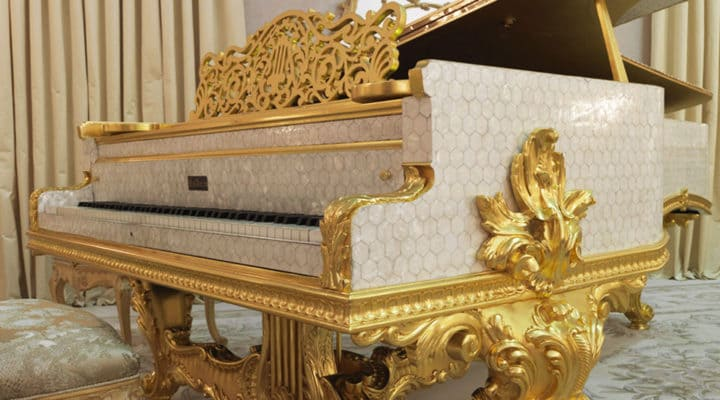 Piano in mother of pearl and gold leaf